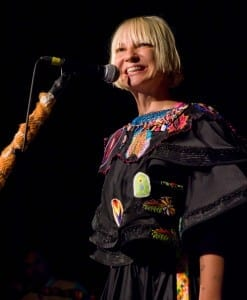 Sia smiling it up and living the dream. / Kirk Stauffer