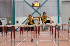 Ian McLellan (left) and Dustin Steininger (right) racing down the Fieldhouse track lanes./Arthur Ward