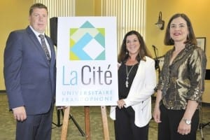 La Cité staff proudly displaying their new logo