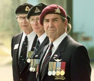 Canadian Veterans share an emotional moment during Remembrance Day ceremonies