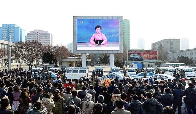"TOPSHOT - In this photograph released by North Korea's official Korean Central News Agency (KCNA) on January 6, 2016, North Korean people celebrate the success of the first hydrogen bomb test in Pyongyang. With a surprise nuclear test two days before his birthday, North Korea's young leader Kim Jong-Un has once again asserted his personal control over the hermit state he inherited from his late father four years ago.  AFP PHOTO / KCNA via KNS    REPUBLIC OF KOREA OUT   THIS PICTURE WAS MADE AVAILABLE BY A THIRD PARTY. AFP CAN NOT INDEPENDENTLY VERIFY THE AUTHENTICITY, LOCATION, DATE AND CONTENT OF THIS IMAGE. THIS PHOTO IS DISTRIBUTED EXACTLY AS RECEIVED BY AFP. ---EDITORS NOTE--- RESTRICTED TO EDITORIAL USE - MANDATORY CREDIT ""AFP PHOTO / KCNA VIA KNS"" - NO MARKETING NO ADVERTISING CAMPAIGNS - DISTRIBUTED AS A SERVICE TO CLIENTS / AFP / KCNA / KNS"