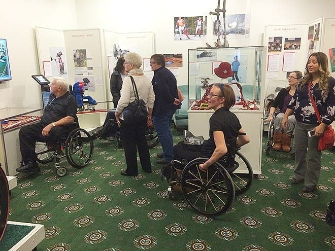 Patrons visit the new exhibit./ Photo courtesy of the Saskatchewan Sports Hall of Fame
