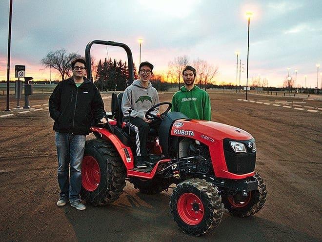 Dean Kertai, Sam Dietrich, and Caleb Friedrick (L-R) pose with their AgBot. Photo - U of R Agriculture Robotics Club