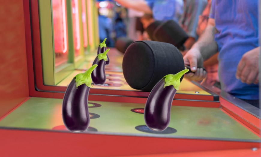 The game whack-a-mole set in an arcade, with several eggplants edited to sit over the holes the moles would come out of