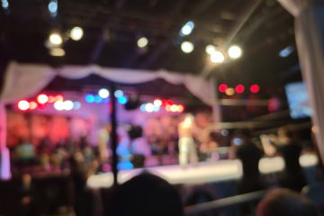 An out-of-focus photo of a wrestling ring during AAW United We Stand on July 9, 2021 in Merrionette Park, Illinois